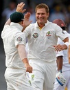 Ryan Harris is congratulated after dismissing Shivnarine Chanderpaul