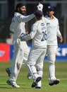 Monty Panesar high fives Sussex wicketkeeper Ben Brown, Lancashire v Sussex, County Championship, Division One, Aigburth, April 12, 2012
