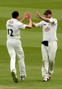 Tim Linley celebrates a wicket with team-mate Tom Maynard