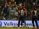 Shahbaz Nadeem celebrates the fall of a wicket with Umesh Yadav