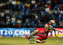AB de Villiers trips while trying to hit a six, Royal Challengers Bangalore v Pune Warriors, IPL, Bangalore, April 17, 2012