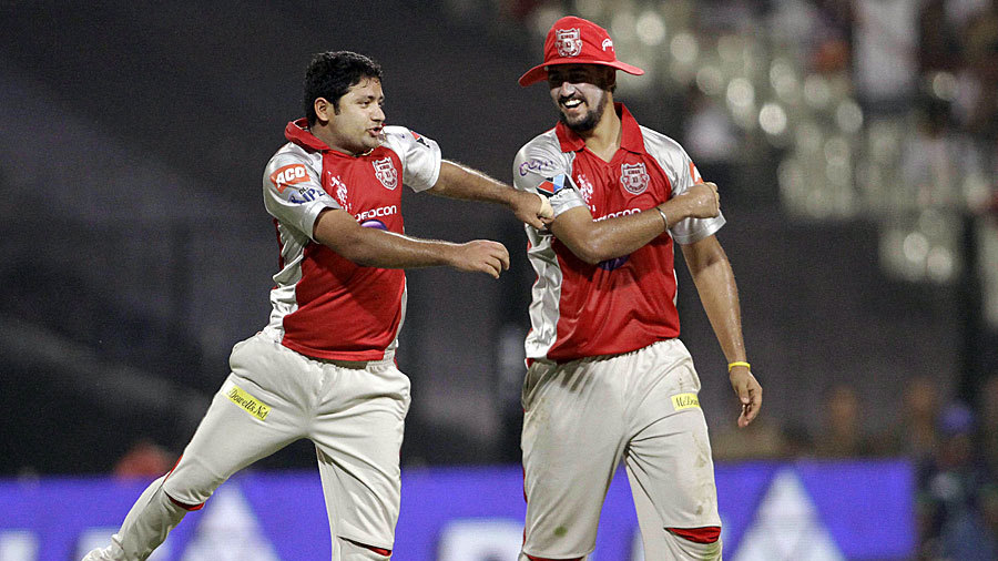 Piyush Chawla and Harmeet Singh celebrate a wicket