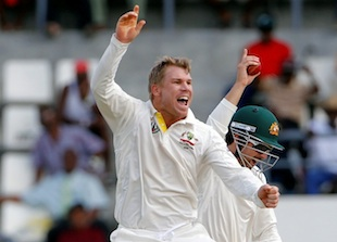 David Warner jumps for joy after taking a wicket, West Indies v Australia, 3rd Test, Roseau, 2nd day, April 24, 2012