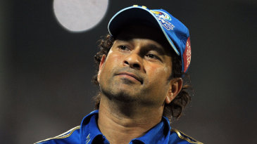 Sachin Tendulkar looks on as Delhi Daredevils run up a big score