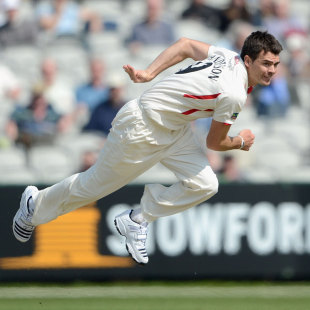 James Anderson follows through after delivering the ball, Lancashire v Nottinghamshire, County Championship, Division One, Old Trafford, 1st day, May 2, 2012