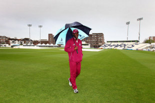 Darren Sammy needs his umbrella as he inspects the pitch, press conference, Hove, May 3, 2012