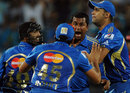 Team-mates congratulate Pragyan Ojha for a wicket, Pune Warriors v Mumbai Indians, IPL, Pune, May 3, 2012