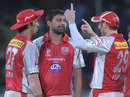 David Hussey talks to Praveen Kumar and Azhar Mahmood, Deccan Chargers v Kings XI Punjab, IPL, Hyderabad, May 8, 2012