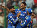 Munaf Patel is all smiles after dismissing Chris Gayle cheaply, Royal Challengers Bangalore v Mumbai Indians, IPL, Bangalore, May 14, 2012
