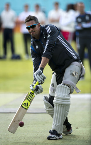 Kevin Pietersen has a bat on the eve of the first Test, Lord's, May 16, 2012