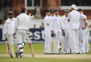 England's players look on after Shivnarine Chanderpaul reviewed an lbw decision against him, England v West Indies, 1st Test, Lord's, 3rd day, May 19, 2012