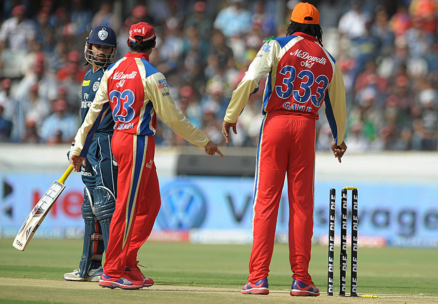 Chris Gayle indicates to the umpire that Shikhar Dhawan was indeed bowled