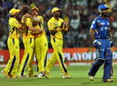 Chennai Super Kings' fielders celebrate the fall of Dinesh Karthik
