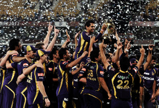 Sunil Narine, the Player of the Tournament, is carried by his team-mates, Kolkata Knight Riders v Chennai Super Kings, IPL 2012, final, Chennai, May 27, 2012