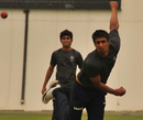 Rahul Sharma bowls during practice