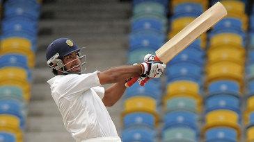Cheteshwar Pujara pulls during his unbeaten 96