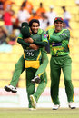Mohammad Hafeez is congratulated on Kumar Sangakkara's wicket