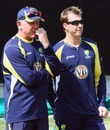 Craig McDermott and Brett Lee chat during a training session, Cape Town, October 12, 2011