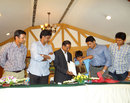 Rahul Dravid, Javagal Srinath, Anil Kumble and Venkatesh Prasad watch as  Sunil Joshi is presented a book by his son, Bangalore, June 21, 2012