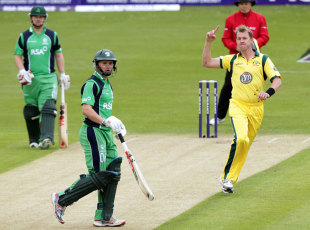 Brett Lee celebrates after bowling William Porterfield with the opening delivery of the match, Ireland v Australia, ODI, Stormont, June 23, 2012