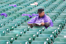 A spectator braves the conditions in Belfast, Ireland v Australia, ODI, Stormont, June 23, 2012