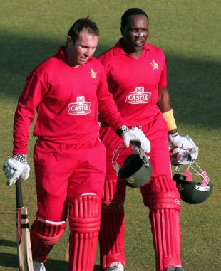 Brendan Taylor and Hamilton Masakadza walk off after the victory, Zimbabwe v South Africa, T20 tri-series final, Harare, June 24, 2012