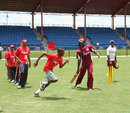 Chris Gayle and Fidel Edwards work with some local youth
