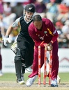 Samuel Badree breaks the stumps to run out Kane Williamson, West Indies v New Zealand, 2nd Twenty20, Florida, July 1, 2012