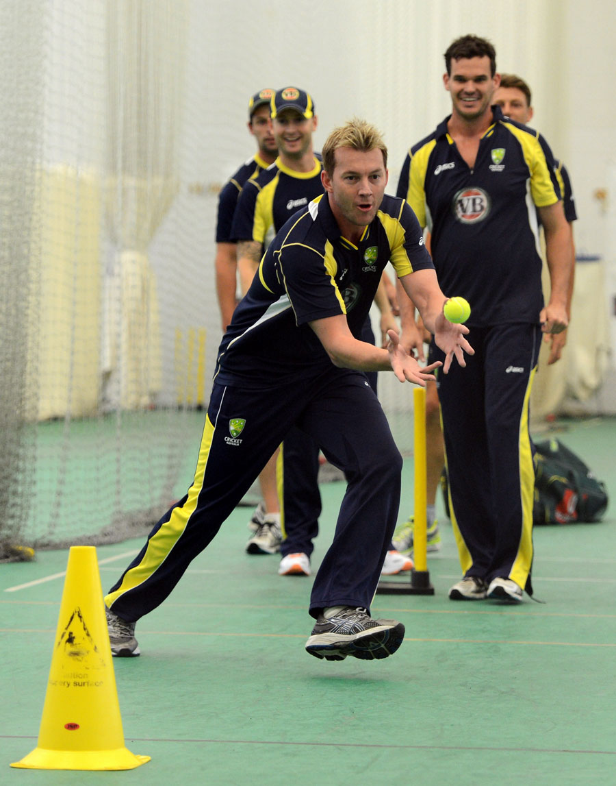 Brett Lee catches the ball during indoor practice