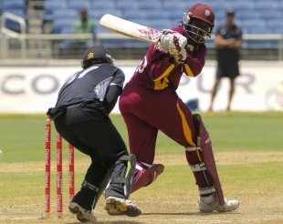 Chris Gayle hits a boundary to get to his 20th ODI century, West Indies v New Zealand, 2nd ODI, Kingston, July 7, 2012
