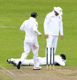 Mark Boucher lies on the ground after being struck in the eye, Somerset v South Africans, Tour Match, Taunton, 1st day, July 9, 2012