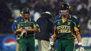 Mark Boucher and Lance Klusener walk off in the rain