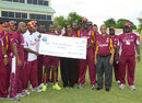The West Indies team hand over a cheque to Runako Morton's widow, West Indies v New Zealand, 3rd ODI, Basseterre, July 11, 2012