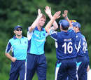 Scotland's Alasdair Evans celebrates an early wicket, Scotland v Canada, ICC World Cricket League Championship, Ayr, July 12, 2012