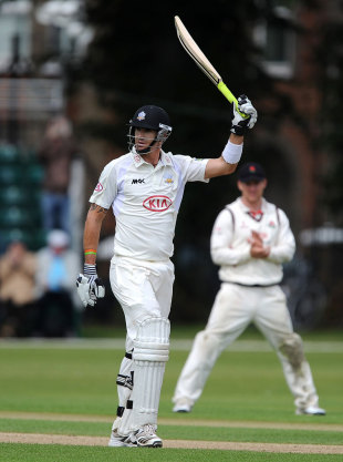 Kevin Pietersen raises his bat after reaching his century, Surrey v Lancashire, County Championship, Division One, 3rd day, Guildford, July 11, 2012