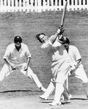 Lord Cobham lofts one to the leg side while MCC keeper Jim Parks looks on, Governor-General's XI v MCC, 3rd day, Auckland, February 27, 1961