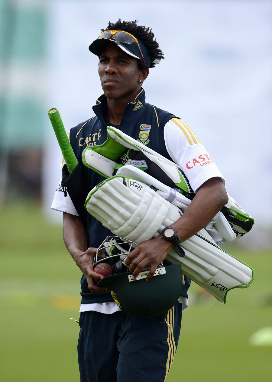 South Africa's Thami Tsolekile heads to practice