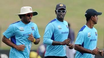 Members of Sri Lanka's pace attack, Lasith Malinga, Angelo Mathews and Nuwan Kulasekara, take a jog around the ground