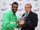 Elias Sunny receives his Man of the Match award, Ireland v Bangladesh, 1st T20, Stormont, July, 18, 2012