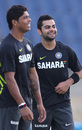 Umesh Yadav and Virat Kohli share a light moment