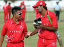 Li Kai Ming and Haseeb Amjad share a lighter moment after Hong Kong's record T20 score against Singapore