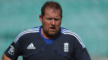 England bowling coach David Saker goes for a run before play
