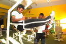 Junaid Siddique (left) and Jahurul Islam work out at the Clemon-Rajshahi Cricket Academy gym, where most of the equipment is made from waste steel materials, 2012