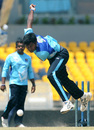 Isuru Udana bowls during a training session in Hambantota, July 23, 2012