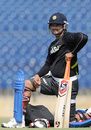 Suresh Raina watches during a training session
