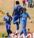 Thisara Perera celebrates the wicket of Suresh Raina