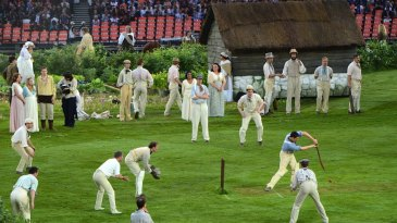 Performers play cricket at the opening ceremony of the Olympics