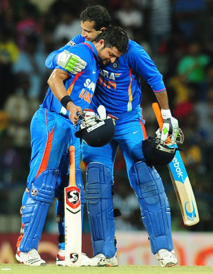 Suresh Raina is congratulated by Irfan Pathan after India's victory off the last over, Sri Lanka v India, 3rd ODI, Colombo, July 28, 2012
