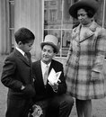 Basil D'Oliveira shows his OBE to his son Damian and wife Naomi, London, October 29, 1969