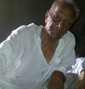 The 85-year-old Israr Ali, Pakistan's oldest living Test cricketer, at his home in Okara, Pakistan, July 2012
